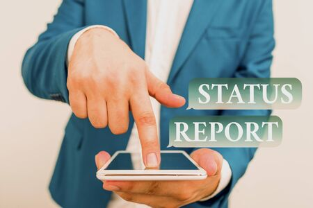 Text sign showing Status Report. Business photo showcasing Update Summary of situations as of a period of time Businessman in the blue suite with lap top pointing with finger