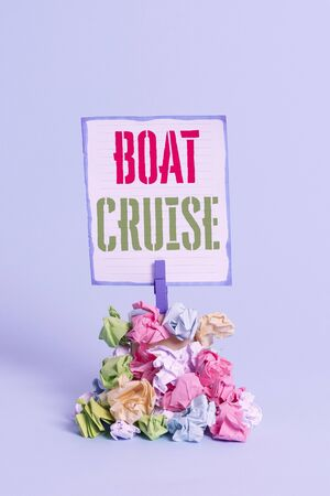Word writing text Boat Cruise. Business photo showcasing sail about in area without precise destination with large ship Reminder pile colored crumpled paper clothespin reminder blue background 写真素材