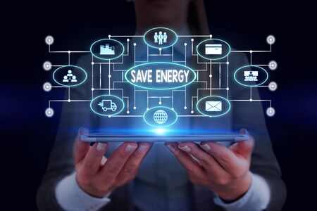 Text sign showing Save Energy. Business photo showcasing decreasing the amount of power used achieving a similar outcome Woman wear formal work suit presenting presentation using smart device