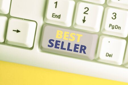 Handwriting text Best Seller. Conceptual photo book or other product that sells in very large numbers White pc keyboard with empty note paper above white background key copy space