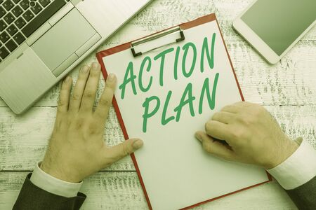 Conceptual hand writing showing Action Plan. Concept meaning list of things or schedule to be made thia current year Zdjęcie Seryjne