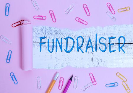 Writing note showing Fundraiser. Business concept for demonstrating whose job or task is seek financial support for charity Zdjęcie Seryjne