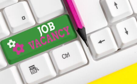 Conceptual hand writing showing Job Vacancy. Concept meaning empty or available paid place in small or big company White pc keyboard with note paper above the white background