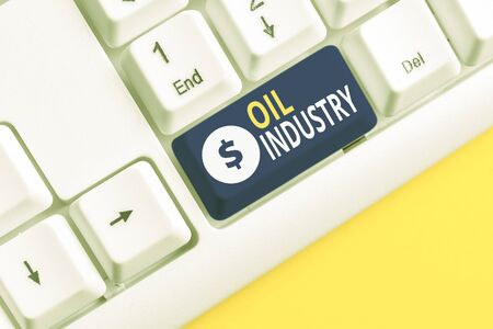 Handwriting text writing Oil Industry. Conceptual photo Exploration Extraction Refining Marketing petroleum products White pc keyboard with empty note paper above white background key copy space