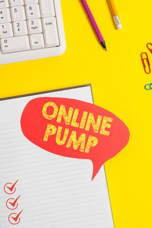 Text sign showing Online Pump. Business photo showcasing device which moves liquid from lower level to higher one Pink empty paper on the yellow table with pencil Stock fotó