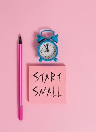 Text sign showing Start Small. Business photo text Small medium enterprises start up Business entrepreneurship Metal vintage alarm clock wakeup blank notepad marker colored background