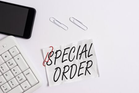 Text sign showing Special Order. Business photo showcasing Specific Item Requested a Routine Memo by Military Headquarters White pc keyboard with empty note paper above white background and mobile phone Stock fotó - 130159276
