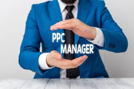 Writing note showing Ppc Manager. Business concept for which advertisers pay fee each time one of their ads is clicked Man holds empty paper with copy space in front of him Space