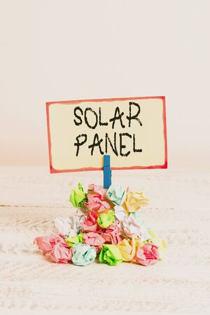 Writing note showing Solar Panel. Business concept for designed to absorb suns rays source of energy generating Reminder pile colored crumpled paper clothespin wooden space