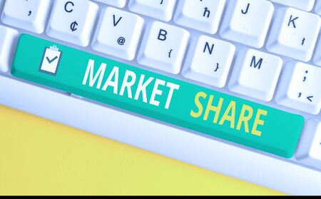 Handwriting text writing Market Share. Conceptual photo The portion of a market controlled by a particular company White pc keyboard with empty note paper above white background key copy space 写真素材