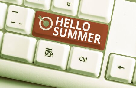 Handwriting text writing Hello Summer. Conceptual photo Welcoming the warmest season of the year comes after spring White pc keyboard with empty note paper above white background key copy space
