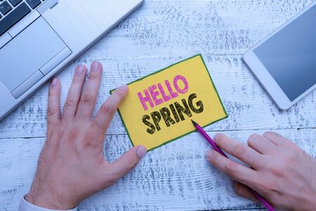 Conceptual hand writing showing Hello Spring. Concept meaning Welcoming the season after the winter Blossoming of flowers