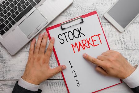 Writing note showing Stock Market. Business concept for Particular market where stocks and bonds are traded or exhange