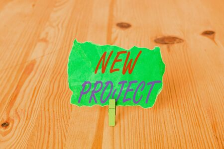 Text sign showing New Project. Business photo showcasing individual enterprise that is planned to achieve particular aim Empty reminder wooden floor background green clothespin groove slot office