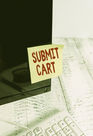 Word writing text Submit Cart. Business photo showcasing Sending shopping list of online items Proceed checkout Notation paper taped to black computer monitor screen near white keyboard Stock fotó - 130159135