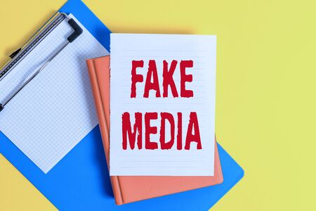 Word writing text Fake Media. Business photo showcasing An formation held by brodcasters which we cannot rely on Pile of empty papers with copy space on the table