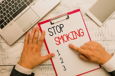 Writing note showing Stop Smoking. Business concept for Discontinuing or stopping the use of tobacco addiction 写真素材