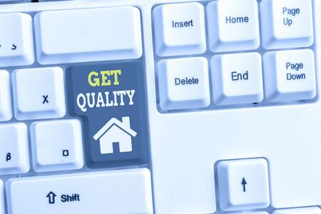 Text sign showing Get Quality. Business photo showcasing features and characteristics of product that satisfy needs White pc keyboard with empty note paper above white background key copy space