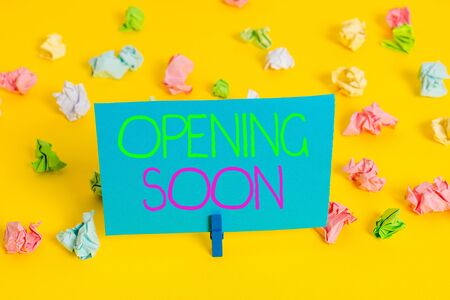 Writing note showing Opening Soon. Business concept for Going to be available or accessible in public anytime shortly Colored crumpled paper empty reminder white floor clothespin Фото со стока