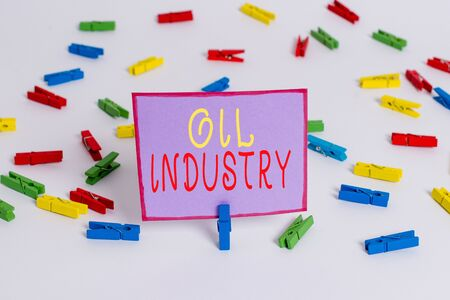 Conceptual hand writing showing Oil Industry. Concept meaning Exploration Extraction Refining Marketing petroleum products Colored clothespin papers empty reminder white floor office