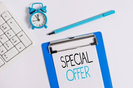 Conceptual hand writing showing Special Offer. Concept meaning Discounted price Markdown Promotional Items Crazy Sale Flat lay above table with clock pc keyboard and note paper