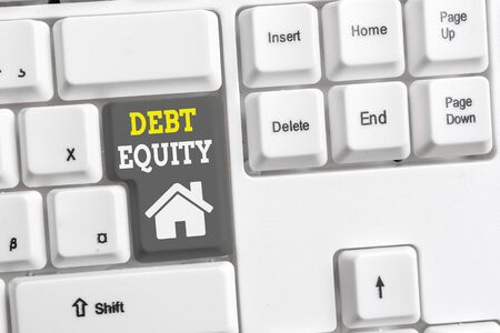 Text sign showing Debt Equity. Business photo showcasing dividing companys total liabilities by its stockholders White pc keyboard with empty note paper above white background key copy space