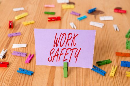 Handwriting text Work Safety. Conceptual photo Policies and control in place according to government standard Colored clothespin papers empty reminder wooden floor background office