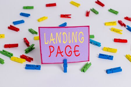 Conceptual hand writing showing Landing Page. Concept meaning Website accessed by clicking a link on another web page Colored clothespin papers empty reminder white floor office
