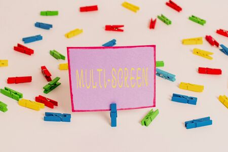 Conceptual hand writing showing Multi Screen. Concept meaning Having or involving several screen especially in a cinema Colored clothespin papers empty reminder white floor office Фото со стока