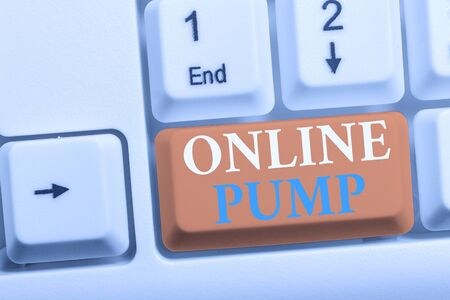 Writing note showing Online Pump. Business concept for device which moves liquid from lower level to higher one White pc keyboard with note paper above the white background Reklamní fotografie