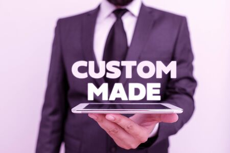 Writing note showing Custom Made. Business concept for something is done to order for particular customer organization Stock Photo