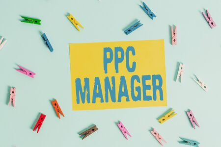 Handwriting text Ppc Manager. Conceptual photo which advertisers pay fee each time one of their ads is clicked Colored clothespin rectangle shaped reminder paper light blue background