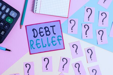 Handwriting text Debt Relief. Conceptual photo partial or total remission of it especially those by countries Mathematics stuff and writing equipment above pastel colours background Zdjęcie Seryjne
