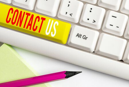 Handwriting text writing Contact Us. Conceptual photo Group of demonstrating that rendering costumer service through telecom White pc keyboard with empty note paper above white background key copy space