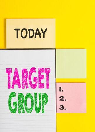 Word writing text Target Group. Business photo showcasing Particular showing that an advertisement intended to reach to Colored empty papers with copy space on the yellow background table