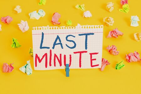 Word writing text Last Minute. Business photo showcasing done or occurring at the latest possible time before event Colored crumpled papers empty reminder white floor background clothespin Фото со стока