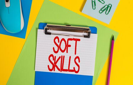 Word writing text Soft Skills. Business photo showcasing demonstratingal attribute enable interact effectively with other showing Clipboard striped sheets marker clips notepad mouse colored background