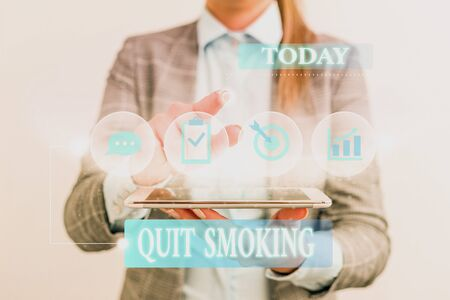 Word writing text Quit Smoking. Business photo showcasing Discontinuing or stopping the use of tobacco addiction Female human wear formal work suit presenting presentation use smart device