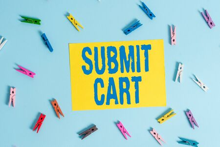 Handwriting text Submit Cart. Conceptual photo Sending shopping list of online items Proceed checkout Colored clothespin rectangle shaped reminder paper light blue background Фото со стока