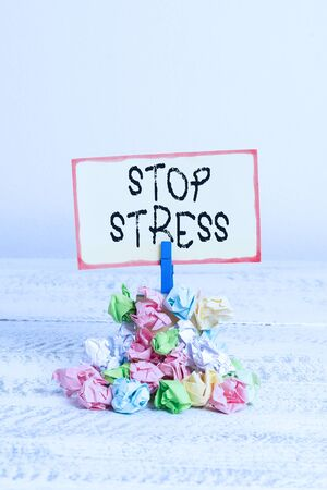 Writing note showing Stop Stress. Business concept for Seek help Take medicines Spend time with loveones Get more sleep Reminder pile colored crumpled paper clothespin wooden space