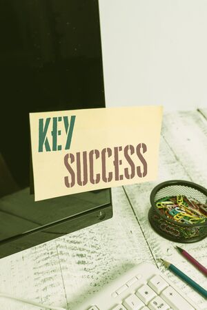 Handwriting text writing Key Success. Conceptual photo generally three to five areas that company may focus on Note paper taped to black computer screen near keyboard and stationary