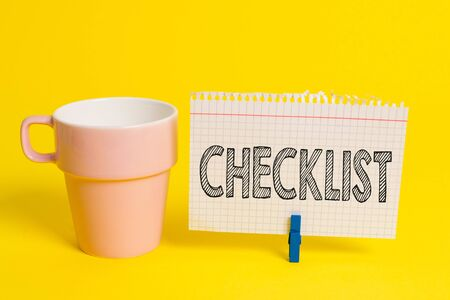 Writing note showing Checklist. Business concept for List down of the detailed activity as guide of doing something Cup empty paper blue clothespin rectangle shaped reminder yellow office