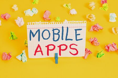 Word writing text Mobile Apps. Business photo showcasing small programs are made to work on phones like app store or app store Colored crumpled papers empty reminder white floor background clothespin