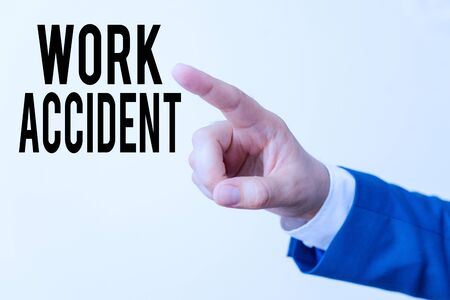 Writing note showing Work Accident. Business concept for Mistake Injury happened in the job place Getting hurt Isolated hand pointing with finger. Business concept pointing finger Zdjęcie Seryjne