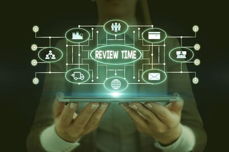 Text sign showing Review Time. Business photo showcasing situation or system its formal examination by showing authority Woman wear formal work suit presenting presentation using smart device