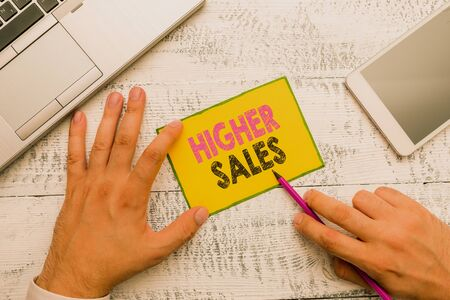 Conceptual hand writing showing Higher Sales. Concept meaning The average sold products and services of a company has grown