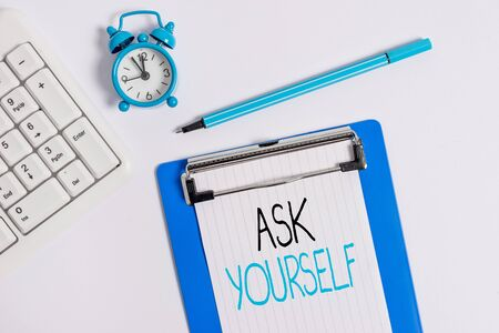 Conceptual hand writing showing Ask Yourself. Concept meaning Thinking the future Meaning and Purpose of Life Goals Flat lay above table with clock pc keyboard and note paper