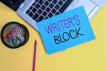 Word writing text Writer S Block. Business photo showcasing Condition of being unable to think of what to write Trendy metallic laptop small paper sheet pencil clips colored background
