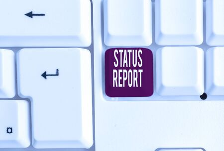 Writing note showing Status Report. Business concept for Update Summary of situations as of a period of time White pc keyboard with note paper above the white background