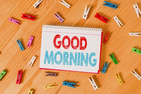 Conceptual hand writing showing Good Morning. Concept meaning A conventional expression at meeting or parting in the morning Colored crumpled papers wooden floor background clothespin
